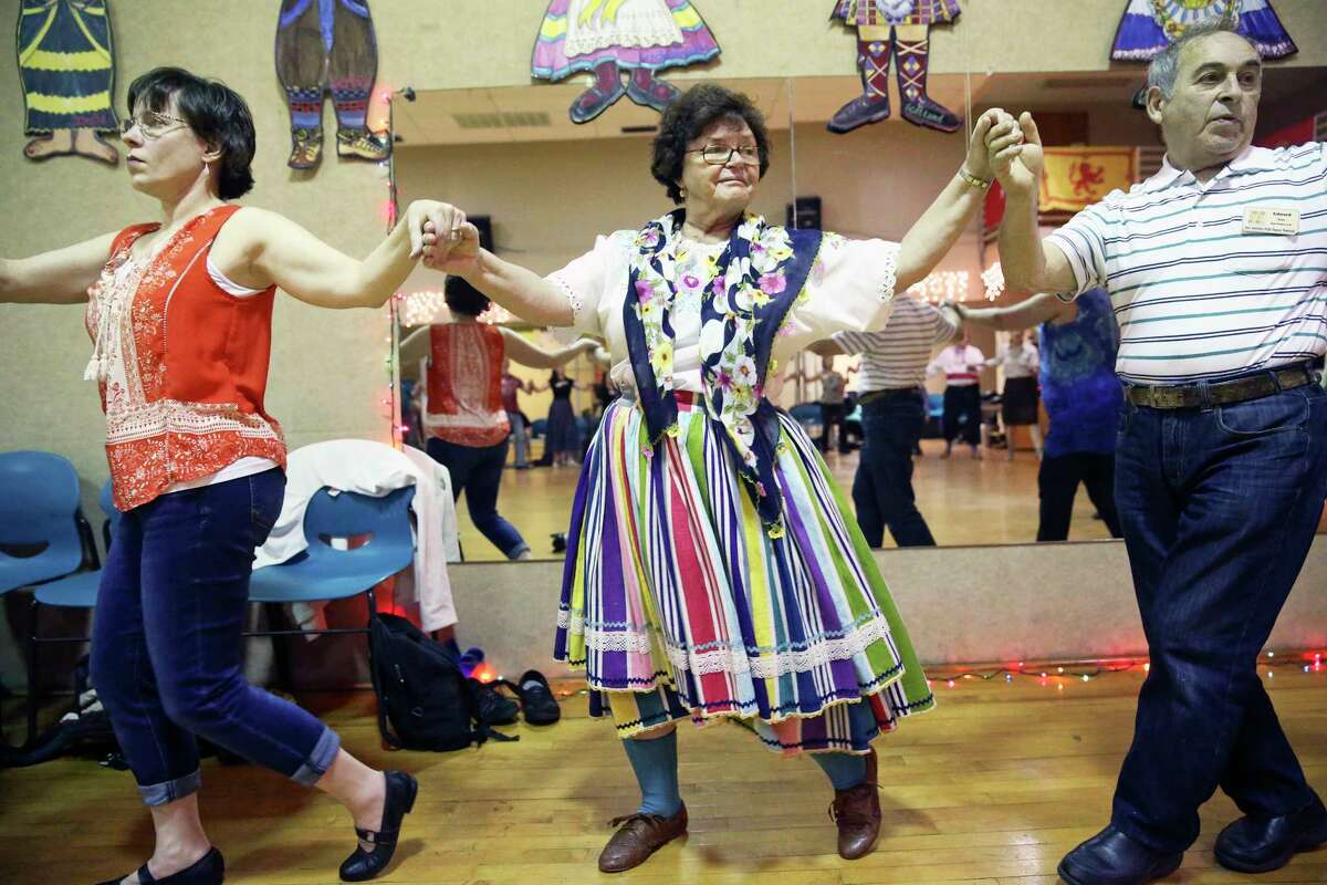 Dancers turn in a big circle as the 59th annual San Antonio Folk Dance Festival offers ethnic dance workshops at the International Folk Culture Center at Our Lady of the Lake University on March 17, 2017. From left are Stefanie Knopp from Newton, Kansas, Pauline Klak from San Pedro , California and Eduard Klak from San Pedro , California.