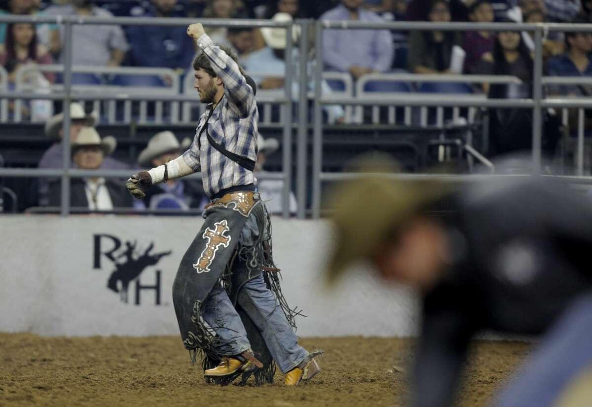 Chad Rutherford celebrates his bareback riding score at the Houston Rodeo on Sunday, March 19, 2017, in Houston. ( Elizabeth Conley / Houston Chronicle )