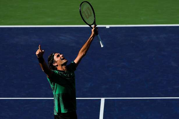 INDIAN WELLS, CA - MARCH 19:  Roger Federer of Switzerland celebrates after defeating Stan Wawrinka of Switzerland in the men's final on day 14 during the BNP Paribas Open at Indian Wells Tennis Garden on March 19, 2017 in Indian Wells, California.  (Photo by Alex Goodlett/Getty Images)