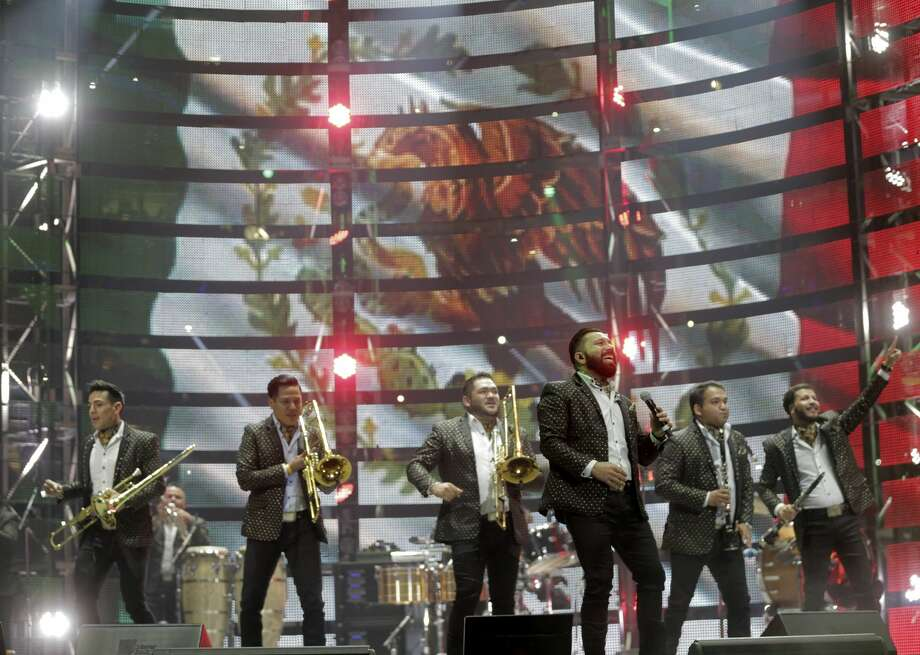 Members of Banda El Recodo perform at the Houston Livestock Show and Rodeo on Sunday, March 19, 2017, in Houston. ( Elizabeth Conley / Houston Chronicle ) Photo: Elizabeth Conley/Houston Chronicle