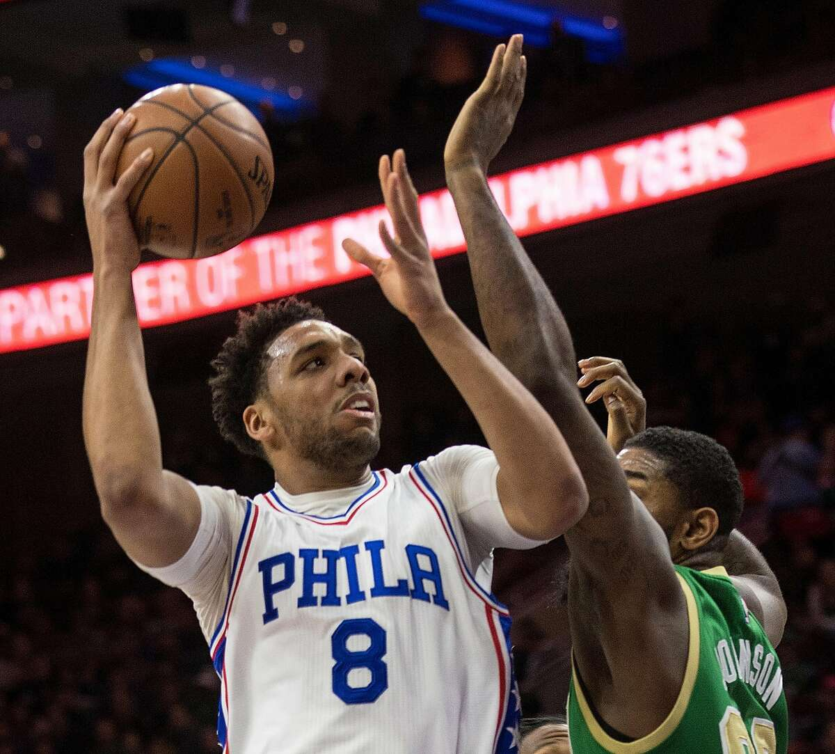 Philadelphia 76ers center Jahlil Okafor shoots against the Boston Celtics during first half action on Sunday, March 19, 2017 in Philadelphia, Pa. Okafor did not play in the second half as the Sixers defeated the Celtics 105-99. (Clem Murray/Philadelphia Inquirer/TNS)