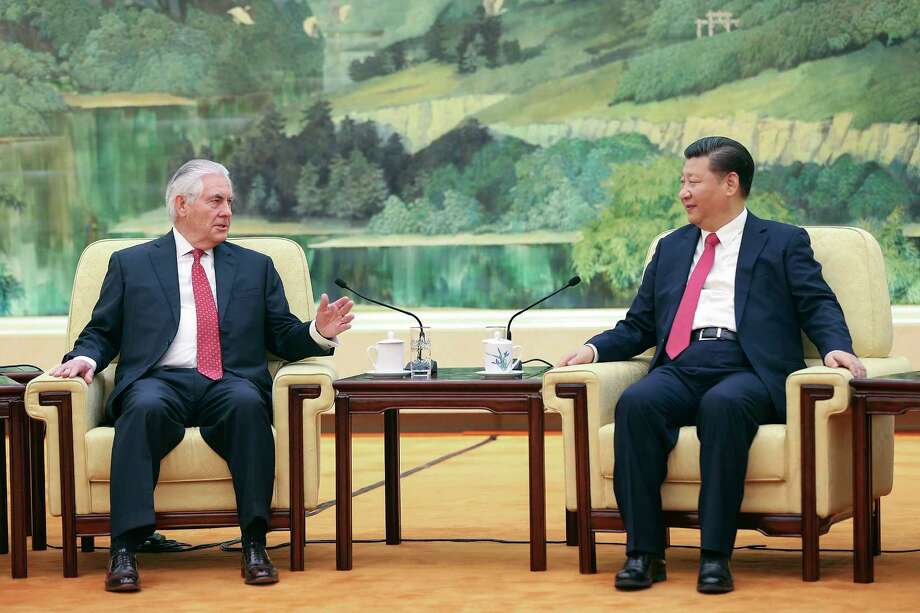 State of Secretary Rex Tillerson chats with China's President Xi Jinping on Sunday in Beijing. Photo: Lintao Zhang, POOL / Getty Images POOL