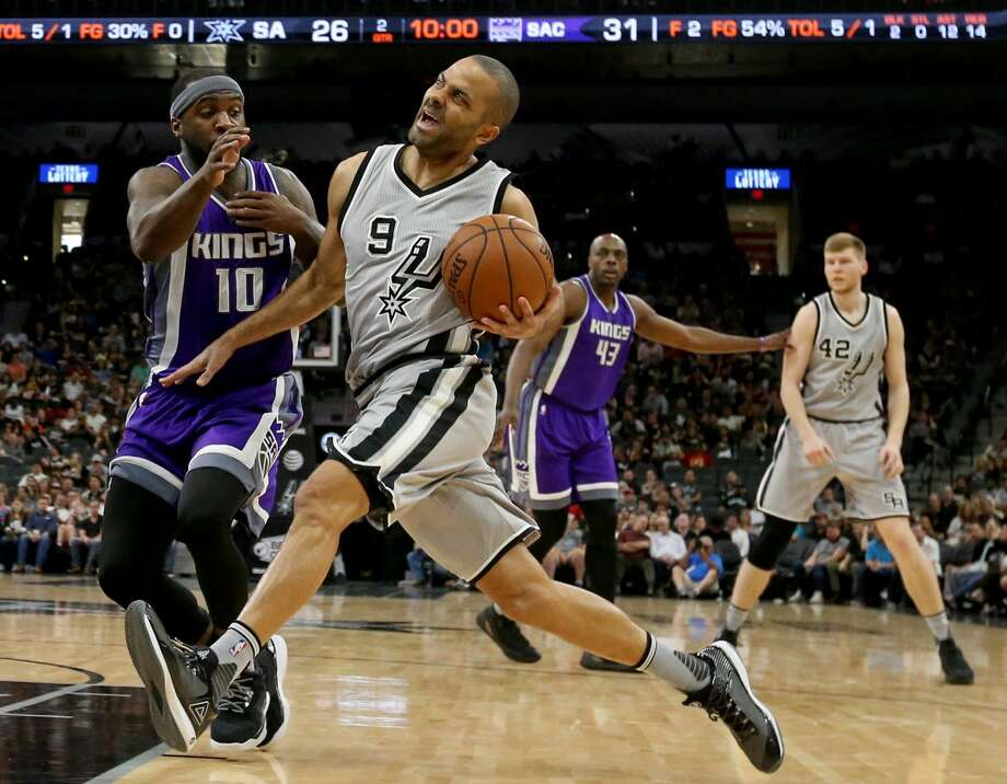 San Antonio Spurs' Tony Parker drives around Sacramento Kings' Ty Lawson during first half action Sunday March 19, 2017 at the AT&T Center. Photo: Edward A. Ornelas/San Antonio Express-News