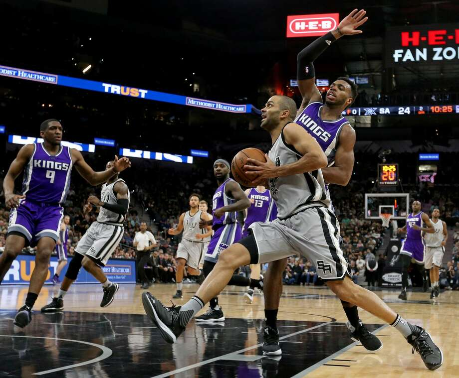 San Antonio Spurs' Tony Parker drives to the basket around Sacramento Kings' Buddy Hield during first half action Sunday March 19, 2017 at the AT&T Center. Photo: Edward A. Ornelas/San Antonio Express-News
