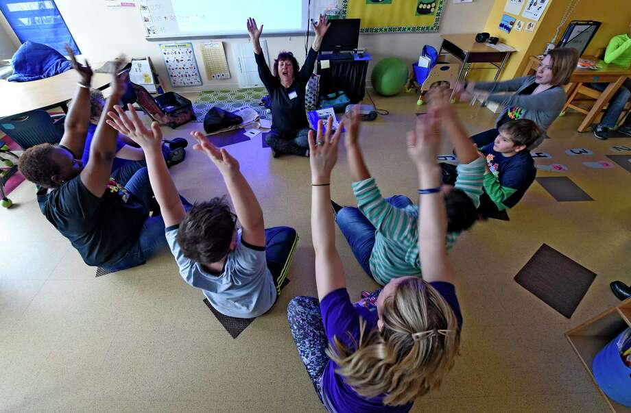 Peg Clark, an occupational therapist and yoga instructor, works with students at Montessori Magnet School using a technique called moga Friday, March 10, 2017 in Albany, N.Y. (Skip Dickstein/Times Union) Photo: SKIP DICKSTEIN / 20039933A