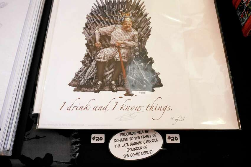 Artwork by artist Christian N. St. Pierre, is seen at his booth inside The Venue during the Upstate New York Collector's Show on Sunday, March 19, 2017, in Cohoes, N.Y. The show which was sponsored by Finnigan's Sportscards in Albany. 100% of admissions is being donated to the family of Darren Carrara, who owned the Comic Depot in Saratoga Springs. Carrara passed away suddenly in November. Some artists at the show, like St. Pierre, were also selling specific drawings with all the proceeds going to the family. On April 2nd, the Albany Toy Show will host an auction during the show to raise money for the family too. The Upstate New York Collector's Show is held in the spring and fall each year. This years fall show will be held in September or October at The Venue. (Paul Buckowski / Times Union)