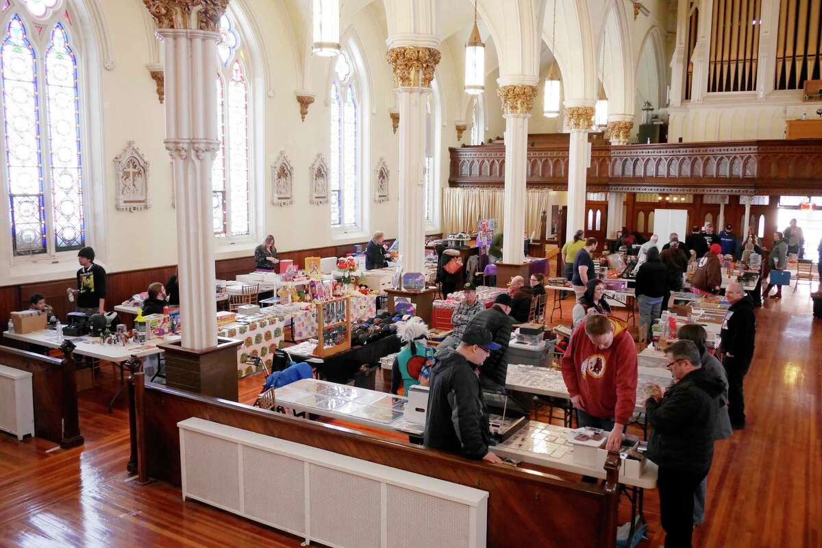 People look over the different items for sale by artists and dealers at The Venue during the Upstate New York Collector's Show on Sunday, March 19, 2017, in Cohoes, N.Y. The show which was sponsored by Finnigan's Sportscards in Albany. 100% of admissions is being donated to the family of Darren Carrara, who owned the Comic Depot in Saratoga Springs. Carrara passed away suddenly in November. Some artists at the show were also selling specific drawings with all the proceeds going to the family. On April 2nd, the Albany Toy Show will host an auction during the show to raise money for the family too. The Upstate New York Collector's Show is held in the spring and fall each year. This years fall show will be held in September or October at The Venue. (Paul Buckowski / Times Union)