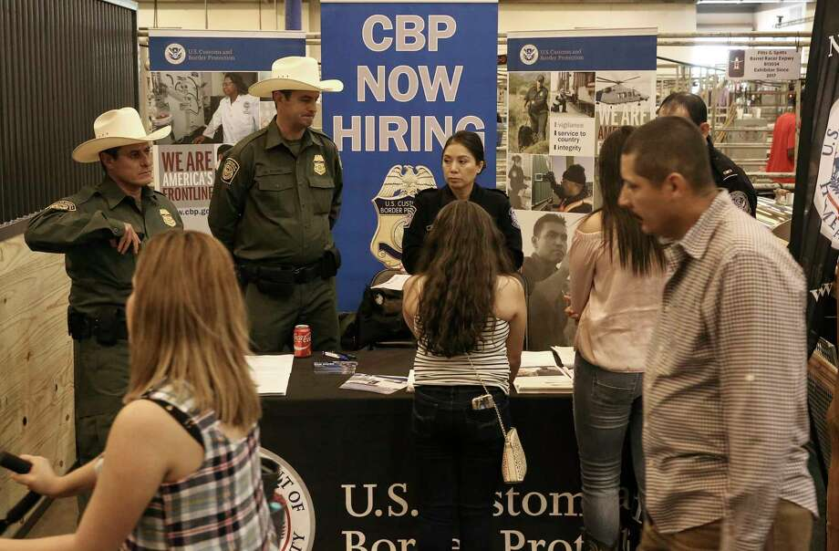 To the chagrin of some, U.S. Customs and Border Patrol recruitment officers were on hand to answer questions Sunday the Houston Livestock Show and Rodeo. Photo: Yi-Chin Lee, Staff / © 2017  Houston Chronicle