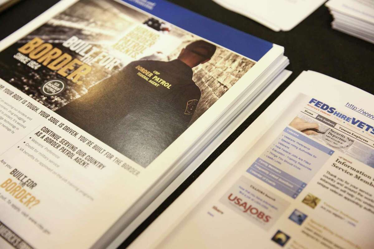 Recruitment materials are laid out at the U.S. Customs and Border Patrol's recruitment booth Sunday at the rodeo.