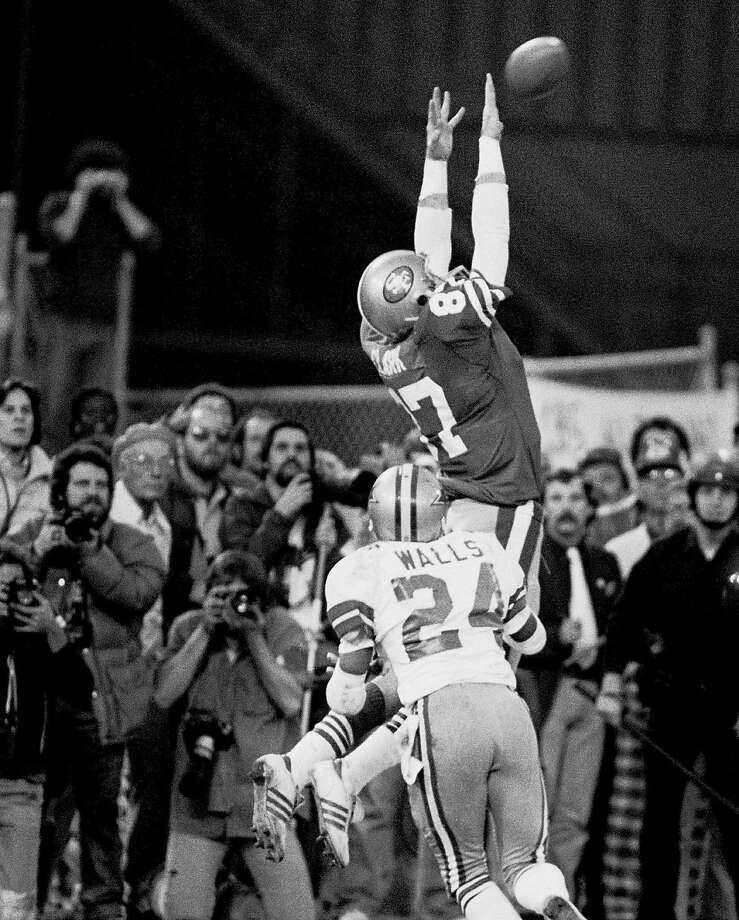 "SF 49ERS DWIGHT CLARK MAKING "" THE CATCH "" 49ERS VS. DALLAS COWBOYS, 10 JAN82, 1981 NFC championship game in San Francisco.  Photo by John Storey/ San Francisco Examiner/Bancroft Library Photo: John Storey / Bancroft Library 1982"
