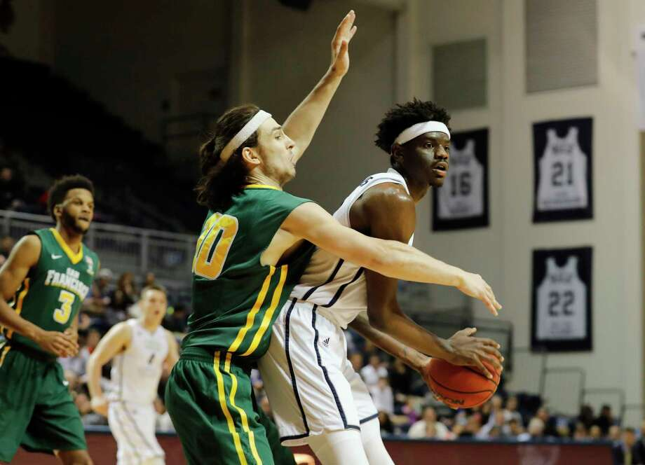 Rice Owls forward Marquez Letcher-Ellis #12 controls a rebound defended by San Francisco Dons forward Matt McCarthy #10 during the second half of the College Basketball Invitational first round game between the San Francisco Dons and the Rice Owls at Tudor Field House in Houston, TX on Wednesday, March 15, 2017.  The Owls defeated the Dons 85-76. Photo: Tim Warner, Freelance / Houston Chronicle
