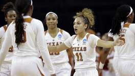 Texas guard Brooke McCarty (11) pulls her teammates together during a second-round game against North Carolina State in the NCAA women's college basketball tournament Sunday, March 19, 2017, in Austin, Texas. (AP Photo/Eric Gay)