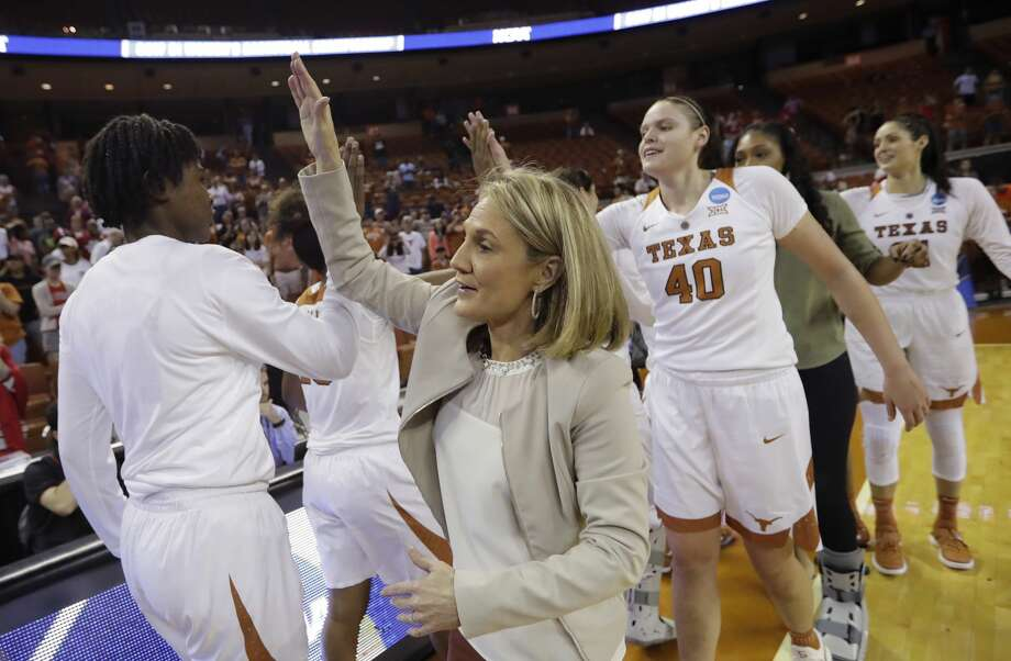 Texas head coach Karen Aston celebrates with her team after their win over North Carolina State in a second-round game in the NCAA women's college basketball tournament, Sunday, March 19, 2017, in Austin, Texas. Texas won 84-80. (AP Photo/Eric Gay) Photo: Eric Gay/Associated Press