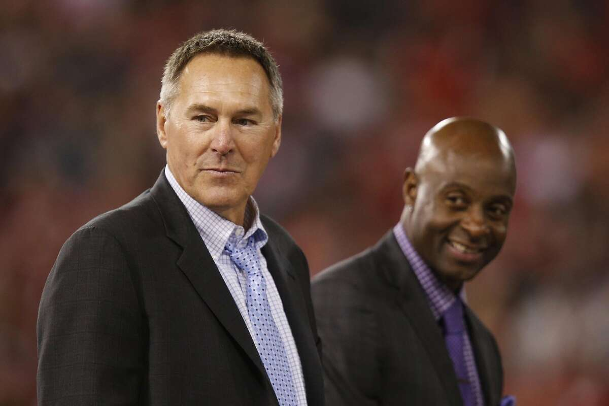 Former San Francisco 49ers tight end Dwight Clark, left, is joined by former San Francisco 49ers wide receiver Jerry Rice during a post game ceremony after the game between the San Francisco 49ers and Atlanta Falcons at Candlestick Park on Monday December 23, 2013 in San Francisco, Calif. The 49ers defeated the Falcons, 34-24, in the last home game the 49ers will have at Candlestick Park before the stadium is demolished.