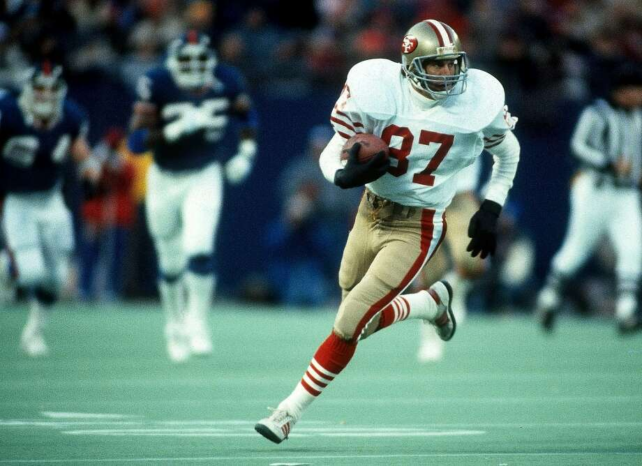 San Francisco 49ers wide receiver Dwight Clark (87) runs with the ball after catching a pass during the NFL 1985 NFC Divisional playoff game against the New York Giants on December 29, 1985 in East Rutherford, New Jersey. The Giants won the game 17-3. (AP Photo/Paul Spinelli) Photo: Paul Spinelli, ASSOCIATED PRESS