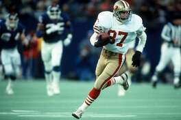 San Francisco 49ers wide receiver Dwight Clark (87) runs with the ball after catching a pass during the NFL 1985 NFC Divisional playoff game against the New York Giants on December 29, 1985 in East Rutherford, New Jersey. The Giants won the game 17-3. (AP Photo/Paul Spinelli)