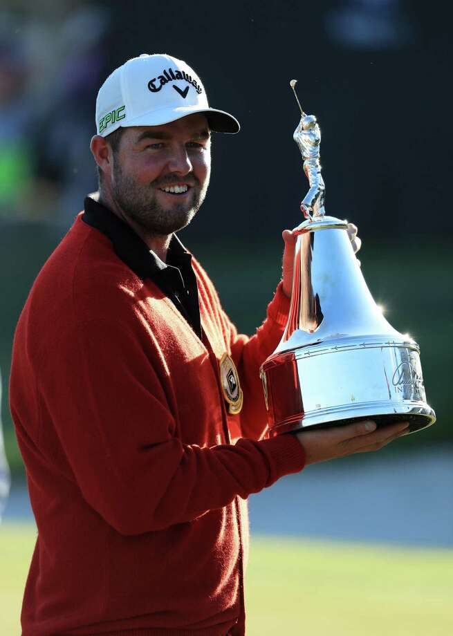 ORLANDO, FL - MARCH 19:  Marc Leishman of Australia celebrates with the winner's trophy on the 18th green after the final round of the Arnold Palmer Invitational Presented By MasterCard at Bay Hill Club and Lodge on March 19, 2017 in Orlando, Florida.  (Photo by Richard Heathcote/Getty Images) ORG XMIT: 686970039 Photo: Richard Heathcote / 2017 Getty Images