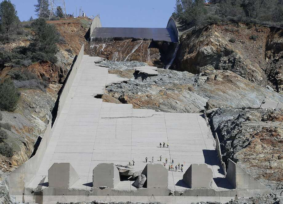 Officials inspect Oroville Dam's crippled spillway last month, where construction crews were busy making fixes to the structure. Photo: Rich Pedroncelli, Associated Press