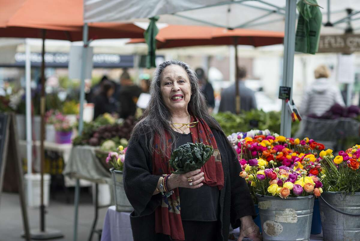 Jeanne Rose stands for a portrait while shopping at the Ferry Plaza Farmers Market where she shops every Saturday morning.
