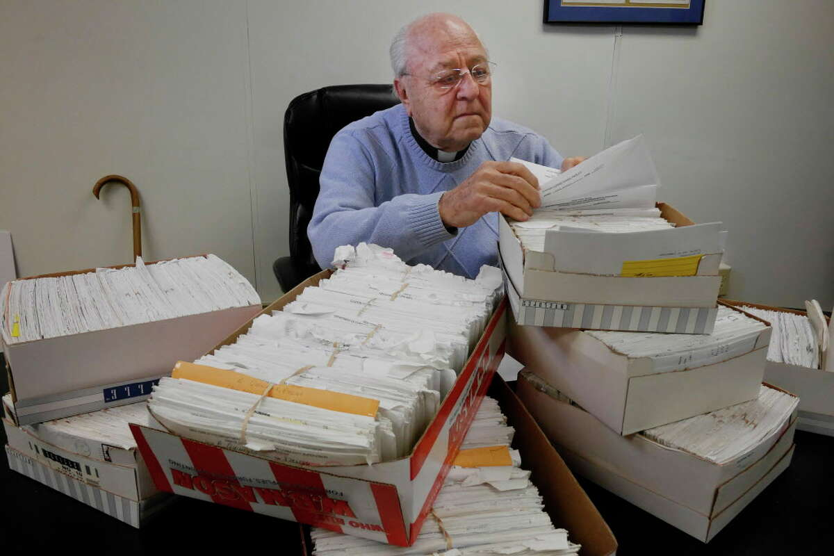 Father Peter Young goes through some of the letters he's received from people in prison in his office in the basement of the Picot Building on Thursday, March 9, 2017, in Albany, N.Y. Father Young said they write to him trying to find services for themselves on their way out of prison.