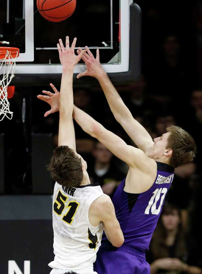 TCU forward Vladimir Brodziansky, right, shoots over Iowa forward Nicholas Baer (51) during the second half of a second-round game in the NIT college basketball tournament, Sunday, March 19, 2017, in Iowa City, Iowa. TCU won 94-92 in overtime. (AP Photo/Charlie Neibergall) ORG XMIT: IACN109 Photo: Charlie Neibergall / Copyright 2017 The Associated Press. All rights reserved.