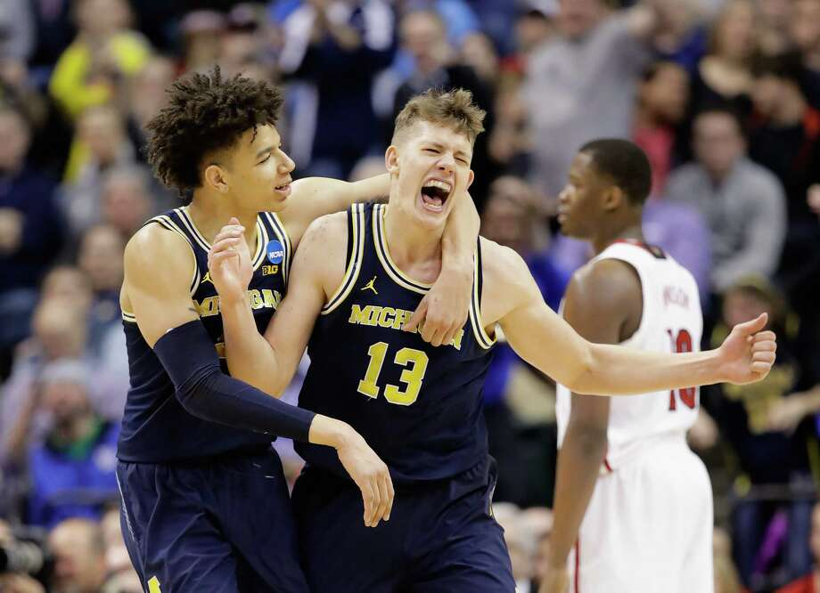 INDIANAPOLIS, IN - MARCH 19:  Moritz Wagner #13 of the Michigan Wolverines celebrates a shot with D.J. Wilson #5 in the second half against the Louisville Cardinals during the second round of the 2017 NCAA Men's Basketball Tournament at the Bankers Life Fieldhouse on March 19, 2017 in Indianapolis, Indiana. Michigan Wolverines won 73-69.  (Photo by Andy Lyons/Getty Images) *** BESTPIX *** Photo: Andy Lyons, Staff / 2017 Getty Images