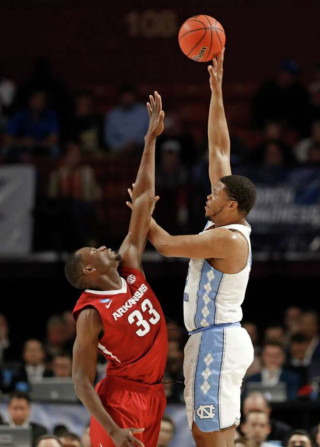 North Carolina's Kennedy Meeks, right, shoots over Arkansas' Moses Kingsley, left, during the first half in a second-round game of the NCAA men's college basketball tournament in Greenville, S.C., Sunday, March 19, 2017. (AP Photo/Chuck Burton) ORG XMIT: SCCB118 Photo: Chuck Burton / Copyright 2017 The Associated Press. All rights reserved.