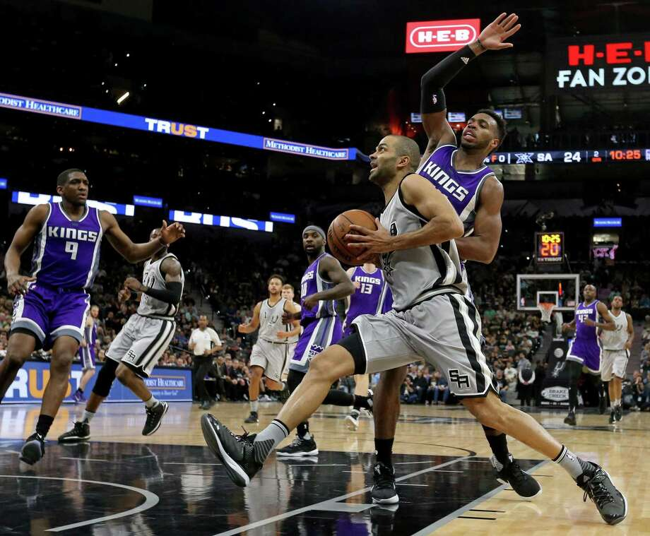San Antonio Spurs' Tony Parker drives to the basket around Sacramento Kings' Buddy Hield during first half action Sunday March 19, 2017 at the AT&T Center. Photo: Edward A. Ornelas, Staff / San Antonio Express-News / © 2017 San Antonio Express-News