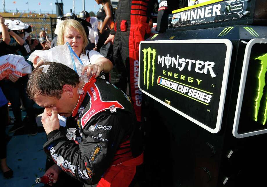 A bag of ice and cold water hits the spot for Ryan Newman after Sunday's Monster Energy Cup victory at Avondale, Ariz. Photo: Jonathan Ferrey, Stringer / 2017 Getty Images