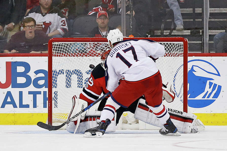 Columbus Blue Jackets center Brandon Dubinsky (17) scores on a penalty shot past New Jersey Devils goalie Cory Schneider (35) during the second period of an NHL hockey game, Sunday, March 19, 2017, in Newark, N.J. (AP Photo/Adam Hunger) ORG XMIT: NJAH109 Photo: Adam Hunger / FR110666 AP