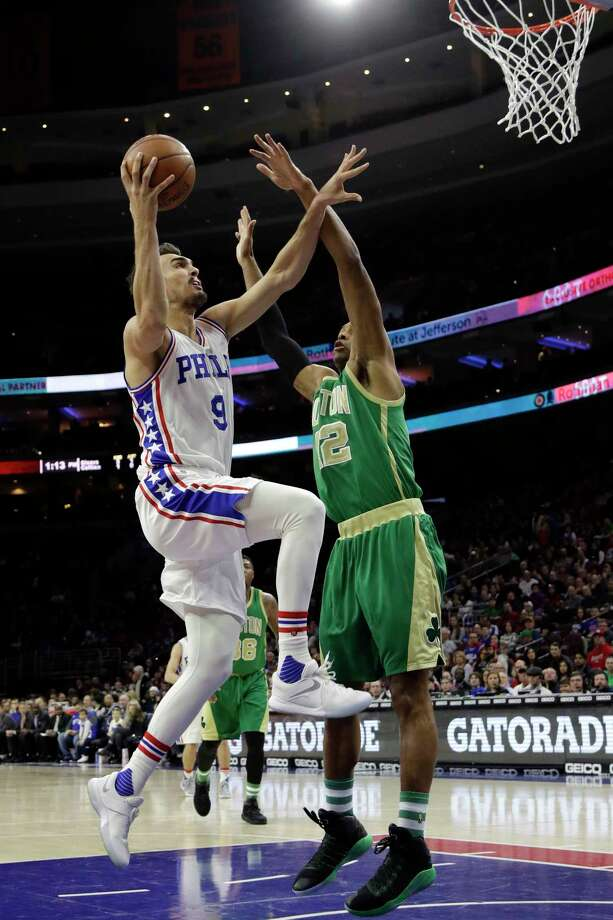 Philadelphia 76ers' Dario Saric (9) goes up for a shot against Boston Celtics' Al Horford (42) during the first half of an NBA basketball game, Sunday, March 19, 2017, in Philadelphia. (AP Photo/Matt Slocum) ORG XMIT: PXC108 Photo: Matt Slocum / Copyright 2017 The Associated Press. All rights reserved.