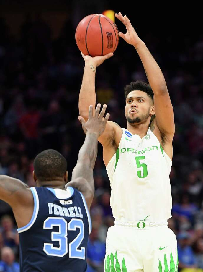 SACRAMENTO, CA - MARCH 19:  Tyler Dorsey #5 of the Oregon Ducks shoots over Jared Terrell #32 of the Rhode Island Rams during the second round of the 2017 NCAA Men's Basketball Tournament at Golden 1 Center on March 19, 2017 in Sacramento, California.  (Photo by Thearon W. Henderson/Getty Images) ORG XMIT: 686516749 Photo: Thearon W. Henderson / 2017 Getty Images