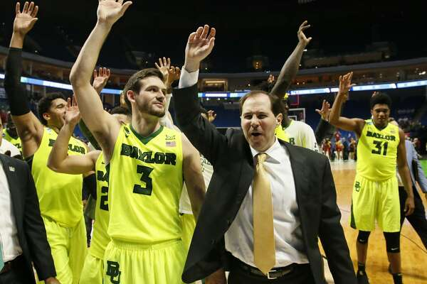 Baylor coach Scott Drew and his team wave to fans following a second-round game against Southern California in the NCAA men's college basketball tournament in Tulsa, Okla., Sunday, March 19, 2017. Baylor won 82-78. (AP Photo/Sue Ogrocki)