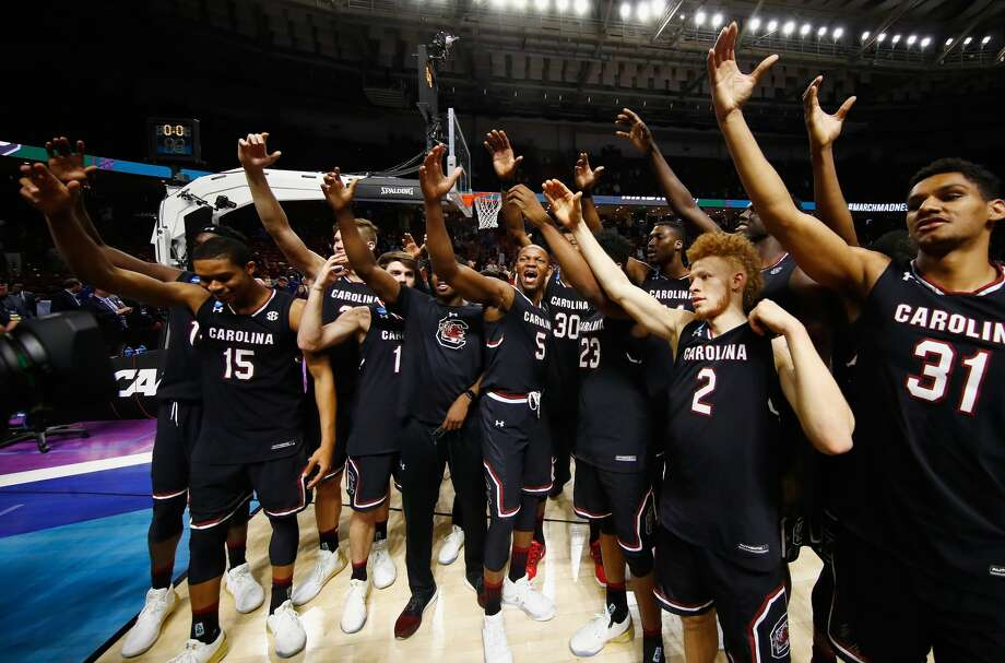 GREENVILLE, SC - MARCH 19:  The South Carolina Gamecocks celebrate defeating the Duke Blue Devils 88-81 in the second round of the 2017 NCAA Men's Basketball Tournament at Bon Secours Wellness Arena on March 19, 2017 in Greenville, South Carolina.  (Photo by Gregory Shamus/Getty Images) Photo: Gregory Shamus/Getty Images