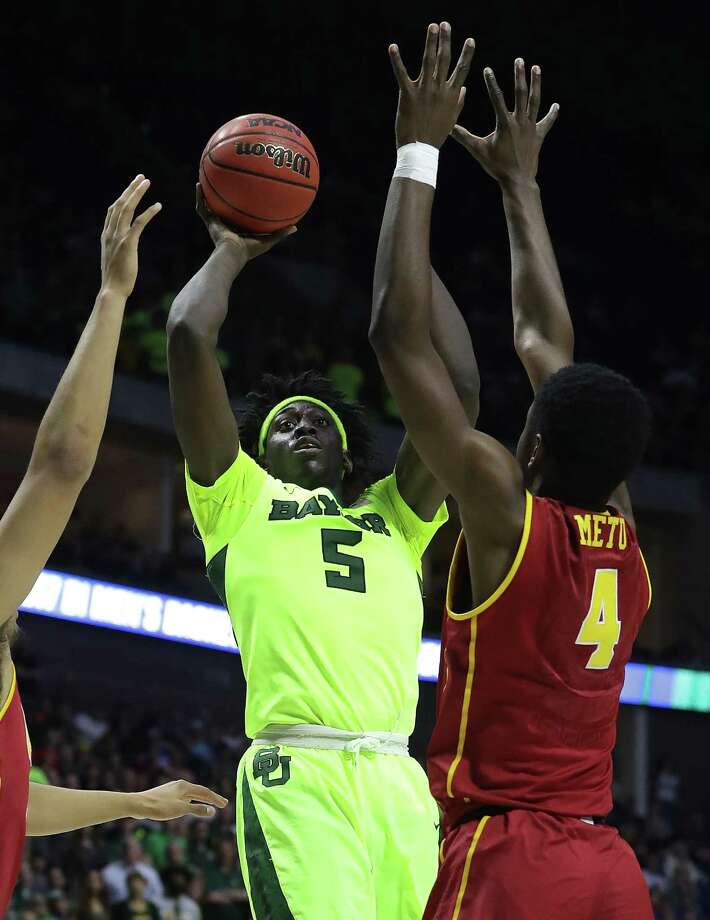 TULSA, OK - MARCH 19:  Johnathan Motley #5 of the Baylor Bears attempts a shot defended by Chimezie Metu #4 of the USC Trojans during the second round of the 2017 NCAA Men's Basketball Tournament at BOK Center on March 19, 2017 in Tulsa, Oklahoma.  (Photo by Ronald Martinez/Getty Images) ORG XMIT: 686516597 Photo: Ronald Martinez / 2017 Getty Images