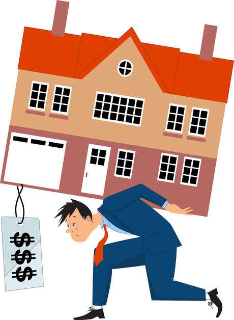 Man overburdened by expensive house. Illustration Photo: Fotolia / aleutie - Fotolia