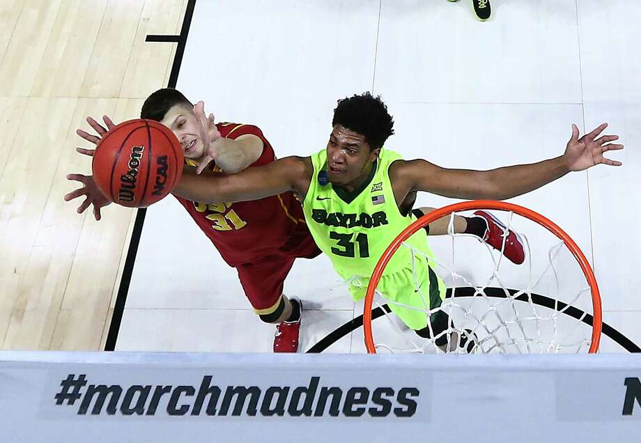 USC's Nick Rakocevic, left, and Baylor's Terry Maston battle for a second-half rebound Sunday night. Maston finished with 19 points and nine boards off the bench. Photo: Ronald Martinez, Staff / 2017 Getty Images