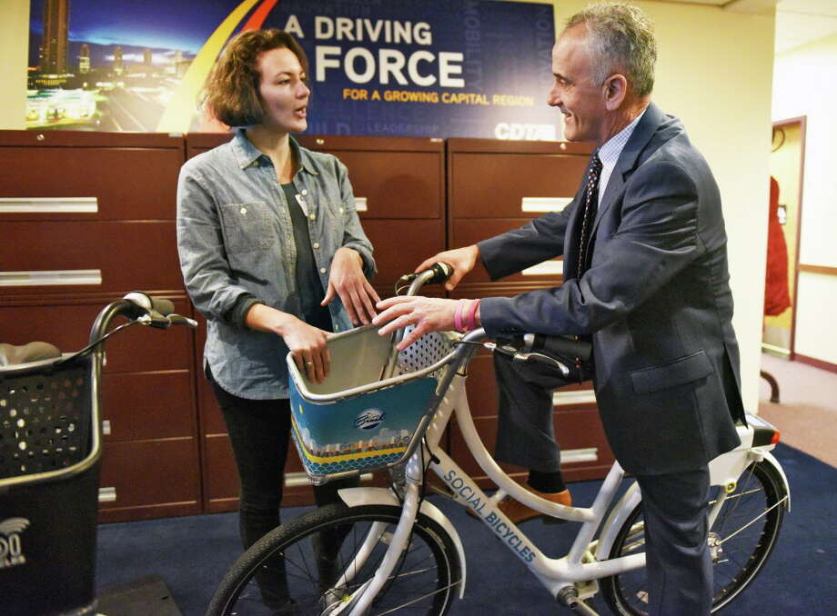 Joanna Jacob of Social Bicycle and CDTA CEO Carm Basile unveil details of CDTA's upcoming bike share program during a news conference Wednesday Dec. 14, 2016 in Albany, NY. The new program will begin this summer,  (John Carl D'Annibale / Times Union) Photo: John Carl D'Annibale / 20039142A