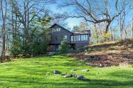 This Swiss chalet at 50 Sunswyck Road is right at home in its coastal community far from the Alps. Some rooms have views of nearby Scott's Cove and Long Island Sound.