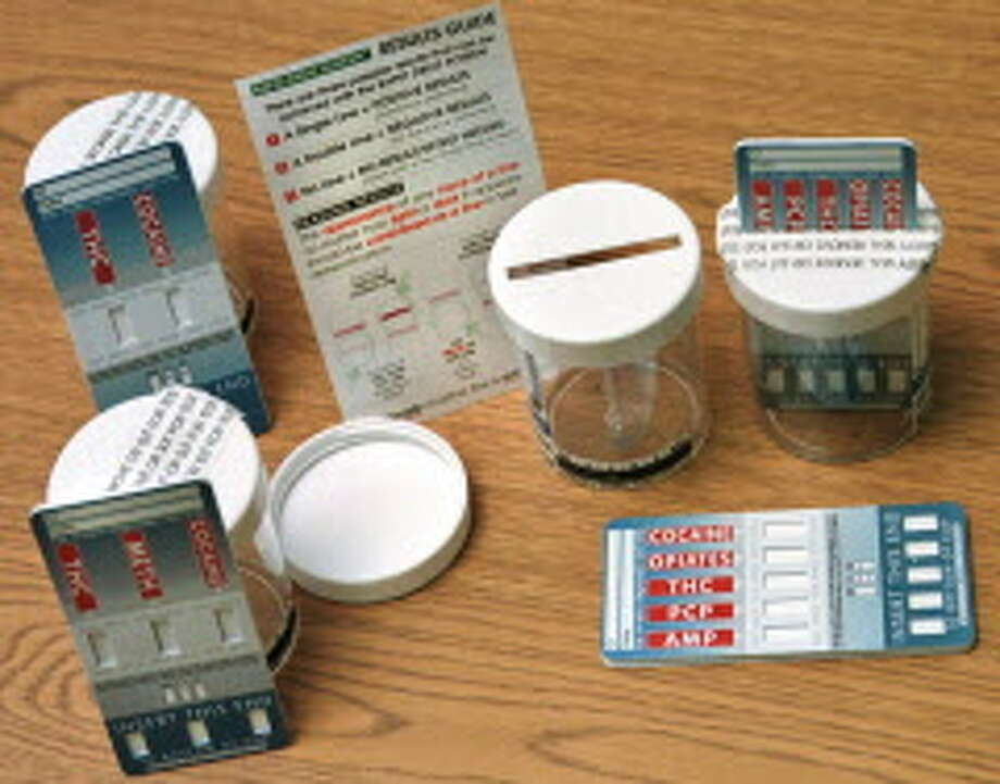 Special to the Times Union photo by Danny Avila  -- American Bio Medica Corp. Rapid Drug Screen cards along with specimen cups and  instructions, Wednesday July 28th 1999 Photo: DANNY AVILA, DG / ALBANY TIMES UNION