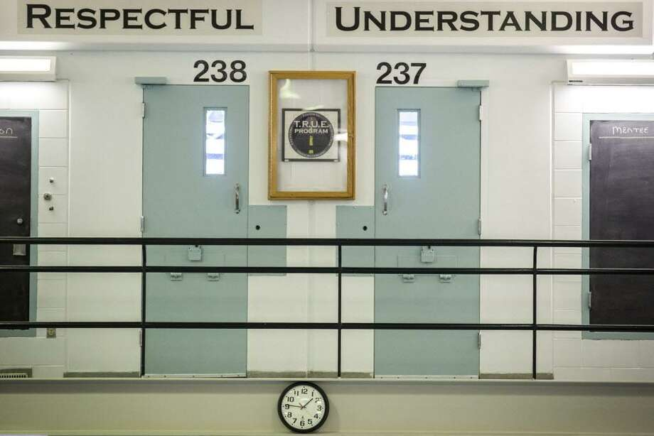 A row of cells in the DOC's new Young Adult Unit at Cheshire Correctional Institution are seen on Monday, March 13, 2017, in Cheshire, Conn. Connecticut has opened a new unit at the Cheshire Correctional Institution to house 18- to 25-year-olds. It's part of Dannel P. Malloy's goal of preventing young adults who've committed nonviolent crimes from becoming career criminals. (Lauren Schneiderman/Hartford Courant via AP) Photo: Lauren Schneiderman / Associated Press / Hartford Courant