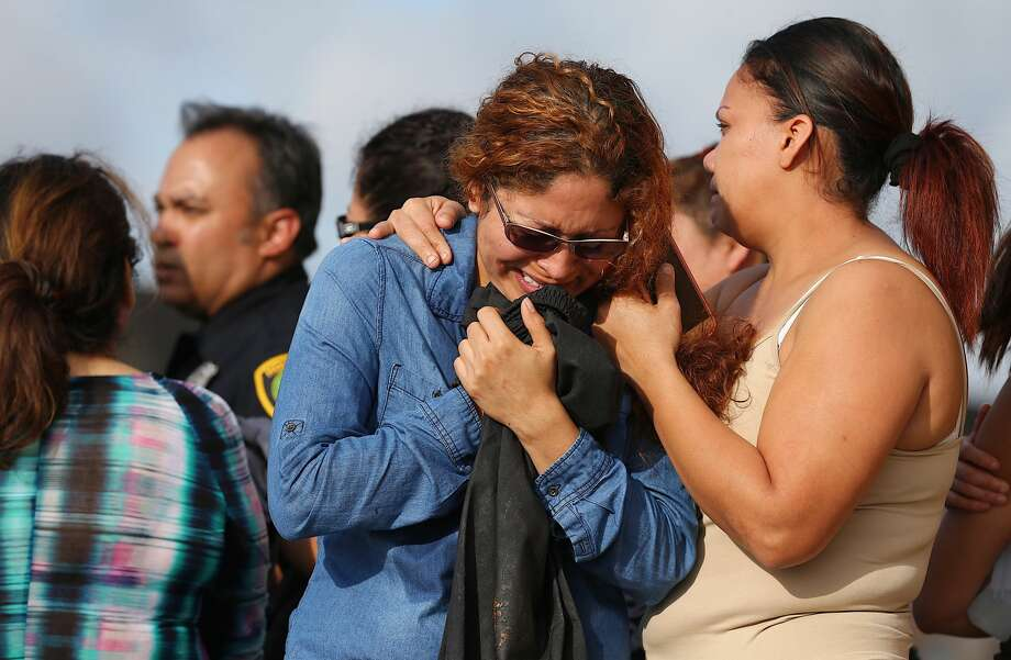 Family members griefs at the scene where Houston Police investigated the death of a woman that was hit by a vehicle on Beechnut Street near Leawood Blvd Monday, March 20, 2017 in Houston. ( Godofredo A. Vasquez / Houston Chronicle ) Photo: Godofredo A. Vasquez