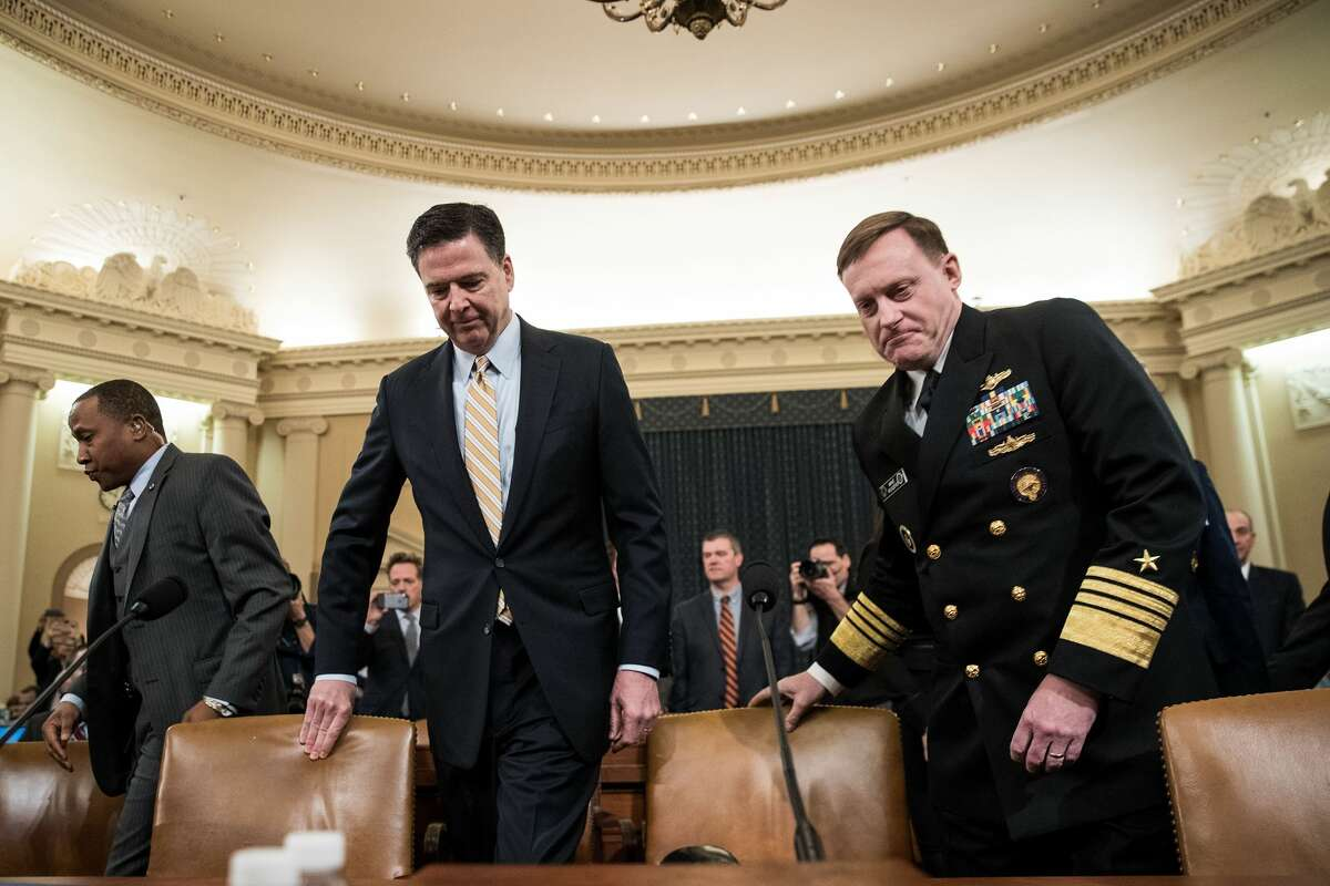 James Comey, Director of the Federal Bureau of Investigation (FBI), and Michael Rogers, Director of the National Security Agency, arrive for a House Permanent Select Committee on Intelligence hearing concerning Russian meddling in the 2016 United States election, on Capitol Hill, March 20, 2017 in Washington. While both the Senate and House Intelligence committees have received private intelligence briefings in recent months, Monday's hearing is the first public hearing on alleged Russian attempts to interfere in the 2016 election. (Photo by Drew Angerer/Getty Images)