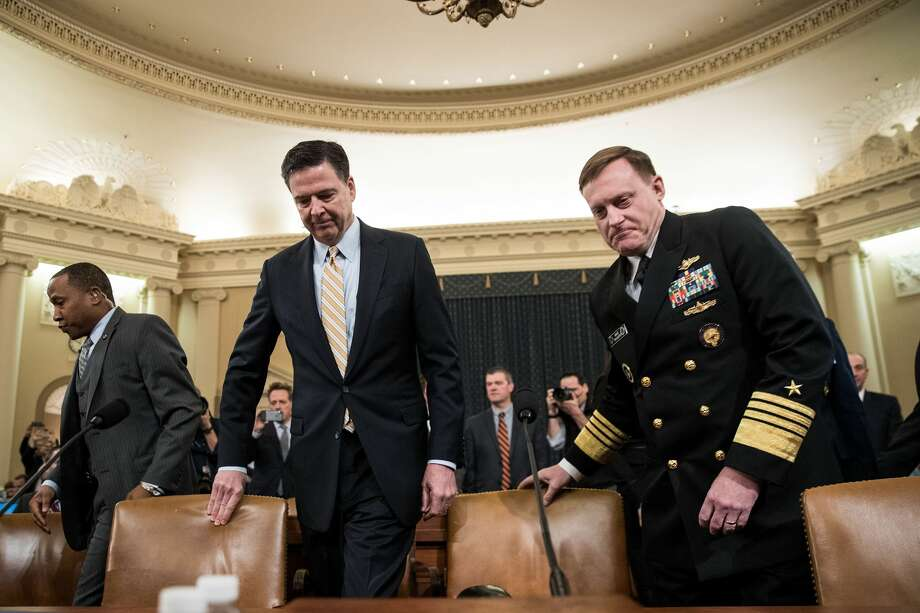 James Comey, Director of the Federal Bureau of Investigation (FBI), and Michael Rogers, Director of the National Security Agency, arrive for a House Permanent Select Committee on Intelligence hearing concerning Russian meddling in the 2016 United States election, on Capitol Hill, March 20, 2017 in Washington.  Photo: Drew Angerer/Getty Images