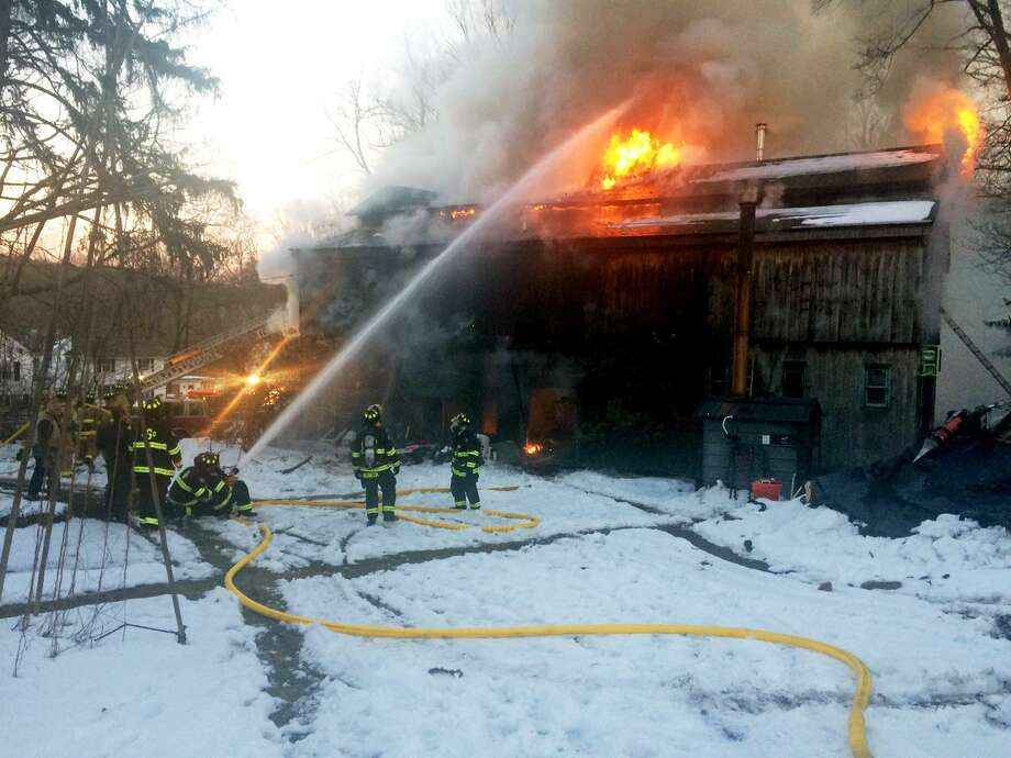 Two people narrowly escaped seriously injury after a workshop burst into flames on Church Street South in Georgetown, Conn. on Sunday, March 19, 2017. The fire appeared to have started in the workshop where one an unidentified man was working on a truck, according to Georgetown Fire Chief Michael Heibeck. Photo: Contributed Photo / Contributed / The News-Times Contributed