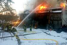 Two people narrowly escaped seriously injury after a workshop burst into flames on Church Street South in Georgetown, Conn. on Sunday, March 19, 2017. The fire appeared to have started in the workshop where one an unidentified man was working on a truck, according to Georgetown Fire Chief Michael Heibeck.