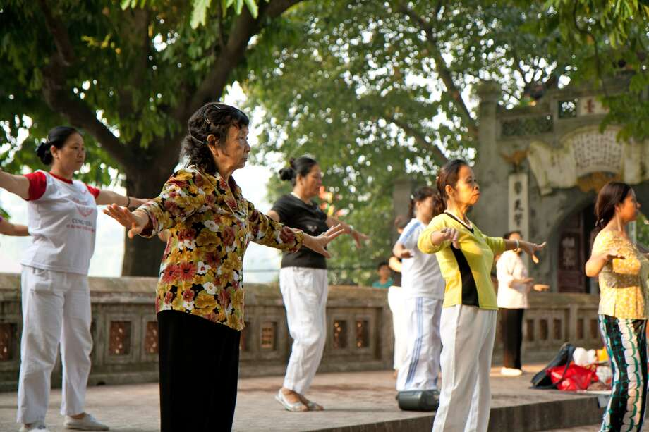 A group of local women seniors dance and exercise at the Hoan Kiem Lake park in Hanoi, Vietnam.