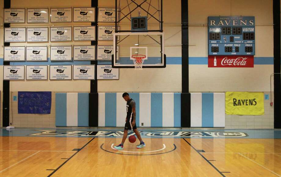 San Jacinto Junior College #23 Elton Dyer, shoots around before practice where the wall pays tribute to past basketball programs Thursday, March 16, 2017, in Pasadena. San Jacinto Junior College announced plans to end its basketball program next sesason, even after their team made the national tournament as a top seed. ( Steve Gonzales  / Houston Chronicle ) Photo: Steve Gonzales, Staff / © 2017 Houston Chronicle