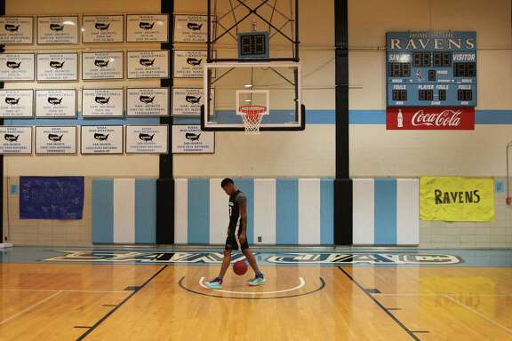 San Jacinto Junior College #23 Elton Dyer, shoots around before practice where the wall pays tribute to past basketball programs Thursday, March 16, 2017, in Pasadena. San Jacinto Junior College announced plans to end its basketball program next sesason, even after their team made the national tournament as a top seed. ( Steve Gonzales  / Houston Chronicle )