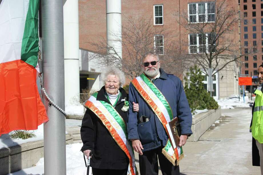 Lois Pont-Briant and John Cullen, 2017 Ancient Order of Hibernians honorees at Stamford Government Center St. Patrick's Day flag raising. Photo: Denise Ryan / Contributed